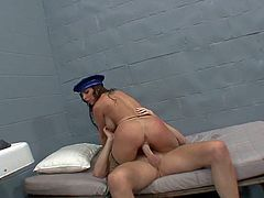 Cock addicted black haired officer Brandy Aniston with big tits and smoking hot round ass in uniform and fishnet stockings gets naked by Mark Wood in his prison cell.