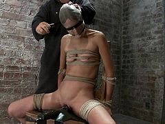 Nylons on her head and tapes on her eyes