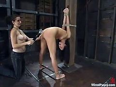 Nasty brunette chick gets tied up and gagged by her mistress. Later on she gets her ass hit with electricity. After that she gets toyed with big dildo and a vibrator.