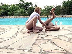 These two were bored so they went in their backyard, near the swimming area to relax. The sluts are not here to swim or sun tan, they are here to show us how they like to fist each other. The slutty brunette goes first as her blonde gf slowly fingers her pussy and then fists it hard! Yeah, that's how we like it!