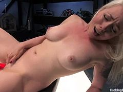 Cute tattooed blonde Lorelei Lee is having a good time in a basement. She strips and demonstrates her body and then gets her cunt pounded hard by a fucking machine.