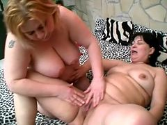 Fat lesbians Rosalie and Lisa are having fun indoors. They knead and kiss each other's big tits and then fuck each other's juicy cunts with a dildo.