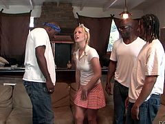 Tara Lynn Foxx is having fun with Wesley Pipes and D-Snoop in the living room. She shows her cock-sucking talent to the dudes and then allows them to pound her pussy doggy style and in other positions.