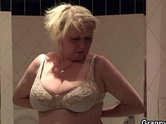 Busty granny Eva is a real hottie! This guy is on a bet and has to fuck as many grandmas he can so Eva is a good shot. He picks her up from the streets and brings her inside the house. There, Eva takes a shower and prepares to fuck. Look at her big, wet boobs and at her pussy that's itching for cock!