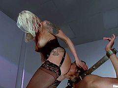Sexy brunette girl gets tied up and hit by electricity. Later on she licks mistress' pussy excitedly.