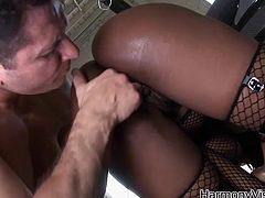 Jada Fire is a hot ebony babe with an amazing ass and big natural tits. Take a look at this hardcore scene where this thick babe has her tight asshole drilled by this big white cock.
