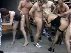 Witness this group sex between two mature ladies and a bunch of guys going crazy in a warehouse. These cougars love having a lot of cocks around!