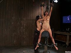 Busty brunette milf Princess Donna Dolore is having fun in a basement. She gets bound, pinched and fucked with a dildo and enjoys every minute of this dirty game.