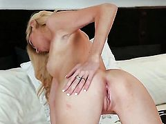 Emily Kae with tiny tits and trimmed bush gives pleasure to herself with toy