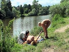 Sweet busty blonde babe joins two older couple in their hot sex act by the river.She really can't hold back and gets her tight shaved pussy fucked by that fat old cock while the fat busty granny is busy rubbing her self.