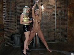 Miss Lee is more than happy now that she has this gorgeous blonde on her hands. Mellanie is a smoking hot babe with a pair of superb boobs that grab Lee's attention. The mistress starts out by attaching electrodes on those hot breasts and then, fucks Mellanie's pussy with a dildo. Curious what else she will do?