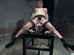 Kinky blonde milf Sabina is having fun with her lesbian GF in a basement. She lets the dominatrix tie her up and then gets her cunt pounded with a wired dildo.