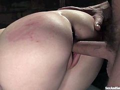 Cute brown-haired girl Kristine is having fun with Steve Holmes in a basement. She sucks his dick hungrily and then Steve beats the girl's pussy with a stick.