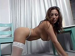 Big booty, sexy legs and a pretty face that asks for a few slaps and cum loads on it. Meet Jelena, one hell of a brunette hottie that needs a hard dick in her ass. She shows us her booty while sitting on that chair and then begins to taunt us some more, with her stockings! For that she should put them in her pussy!