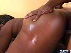 This chubby ebony has a nice pair of tits bouncing when she's getting her black pussy slammed by black cock.