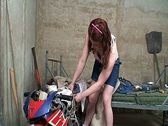 Porner Premium brings you an amazing free porn video where you can see how a cute redhead teen gets banged hard in the garage while assuming very hot poses.