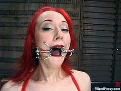 The red haired chick Sabrina Sparx will get strapon fucked and toyed while she's tied with ropes in this lesbian BDSM.