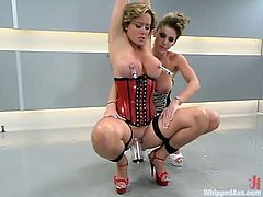 Christina Carter and Kayla Paige are having BDSM fun indoors. The dominatrix binds the milf and humiliates her before smashing her cunt with a massive dildo.