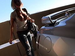Have a look at this hot scene where this sexy blonde flashes her tits in public as she walks out of the airport into the parking lot.