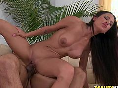 Check this long haired brunette, wearing a fuchsia bra, having wild sex with a horny dude. Amia' slutty look on fer face will give you a boner for sure!