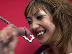 This charming Asian slut is quite a gifted cock sucker. Once she sees her lover's dick she can't resist trying it out. She gets down on her knees and gives him the best blowjob of his life.