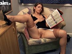 Watch this horny babe fingering her wet pussy on a sofa before she's fucked silly by this guy as you hear her moan and sigh while she takes a pounding.