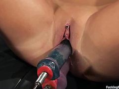 Stunning blonde chick toys her pussy with a vibrator. After that she uses the fucking machine which drills her pussy and ass at the same time.