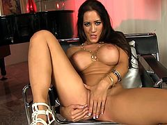 Brunette goddess moans hard while banging her shaved twat with a big toy