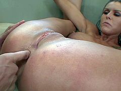 Tempting naive looking brunette with big firm gazongas and long legs fingers her round firm ass while riding on Michael Stefano and gets shaved sweet pussy licked on couch.