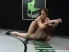 Redhead sluts fight in a ring and then have wild lesbian sex. The losing girl gets her vagina destroyed with a strap-on.