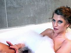 Hot doll posing in the bath