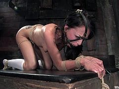 Sexy brunette chick in school uniform gets gagged and tied up by her nasty mistress. Later on she gets toyed rough and tortured with electricity.