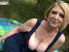 Cougar blonde slut touches her pussy outdoor
