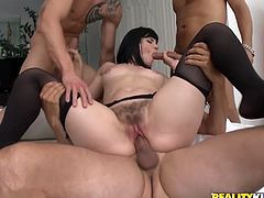 Brunette chick with big ass and boobs has wild sex with three guys. They lick her nipples and pussy at the same time. Then Bobbi demonstrates her blowjob skills and gets fucked rough.