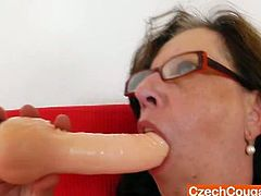 Slavena is sucking her new dildo while wearing nylon stockings and then inserting it in her hairy pussy.Watch hos she lubes her big rubber dildo before she shoves it hard and deep in her hairy cunt