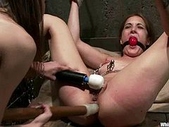 Sexy Kiera King gets spanked by Amber Rayne. After that she rides Sybian saddle and gets suspended and toyed. She gets her ass and pussy toyed at the same time.