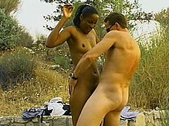 Salacious black chick and her BF go camping. They come to the countryside and have oral sex before banging in standing and other positions on the ground.