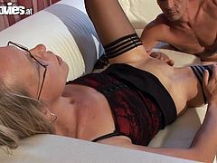 Get a load of this hot scene where a horny blonde mature has her wet pussy drilled by her man in the living room after he catches her masturbating.