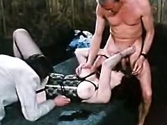Voluptuous black haired MILF shows off her giant tits in front of two guys. Dude lick her dirty hairy twat and treat that phat whore with brutal pussy fisting.