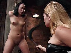 Aiden Starr is getting naughty with brunette hottie Alexa Von Tess in a basement. Alexa gets bound and tortured and then enjoys it when Aiden pounds her coochie with a strapon.
