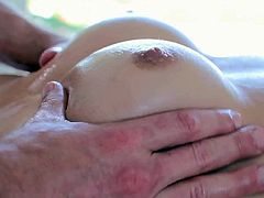 Insolent and very sexy babe receives more than massage from this horny hunk