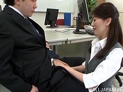 Get a load of this clip where this horny Asian milf sucks on her coworker's hard cock before he bends her over his desk and fucks her silly.