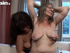 Get a load of this lesbian scene where these horny grannies takes off their clothes and masturbate with toys in the middle of their living room.