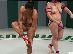 Curvy girls Mistress Kara and Izamar Gutierrez are having a catfight on tatami. The lesbians wrestle with each other and then fuck each other's vags with a strapon.