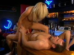 Lustful blonde Holly Wellin is having fun with a man in public. They have ardent oral sex and then bang on the bar counter in cowgirl position.