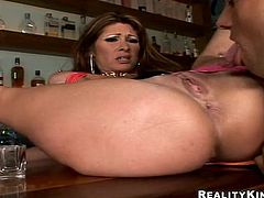 Slutty MILF with big boobs drinks alcohol in a bar. After some time she gives a blowjob to the barman. Then she gets fucked in both holes.
