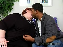 What a sizzling and stunning redhead BBW has come for an interview! She seduces that HR manager and gets his thick black cock in her twat.