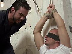Randall O'Reilly gets tied up in a prison cell. After that he gets his ass and dick tortured with electricity. In addition he sucks a dick and gets fucked by Phenix Saint.