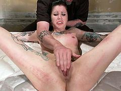 Have fun watching this tattooed lady with small boobs, while she is being tortured and treated like a slutty slave. She really likes hardcore stuff!