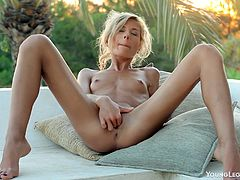 Tight, petite Stephanie relaxes outside, strips off her clothes, and drills her tight, sweet pussy with her favorite toy until she cums hard.
